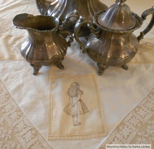 Alice with tea set